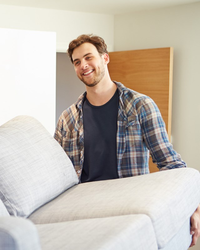 young couple moving couch